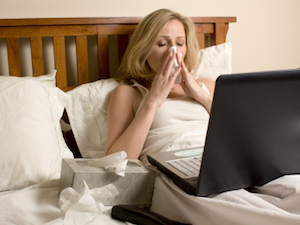 Sick Woman In Bed With Laptop