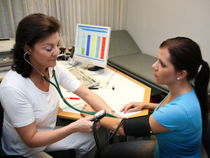 Woman Getting Blood Pressure Taken
